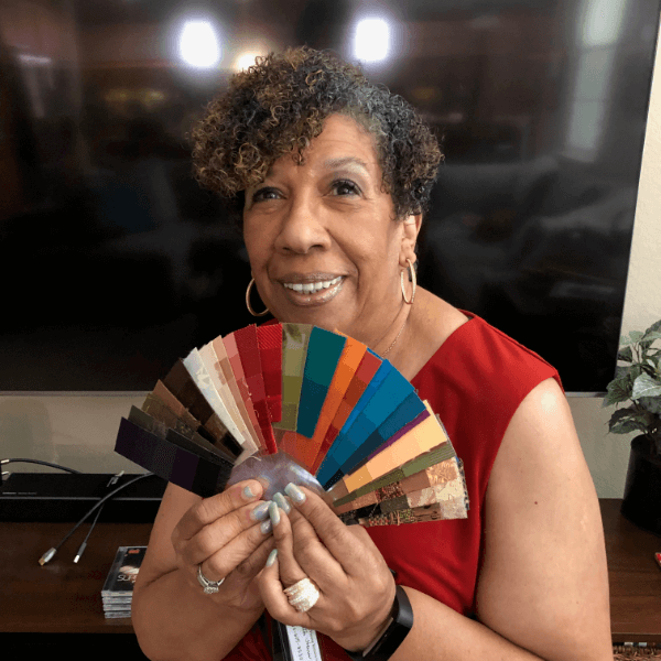 woman of color with color fan cdi